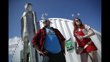 "Jackson Carter and Veronica Savage wait for passes to enter the Storm Area 51 Basecamp event Friday, Sept. 20, 2019, in Hiko, Nev. The event was inspired by the ""Storm Area 51"" internet hoax. (AP Photo/John Locher)"