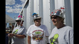 """From left, sisters Kathy Richey, Gerry Garcia and Sandy Haney wait in line for the gift shop at the Storm Area 51 Basecamp event Friday, Sept. 20, 2019, in Hiko, Nev. The event was inspired by the """"Storm Area 51"""" internet hoax. (AP Photo/John Locher)"""