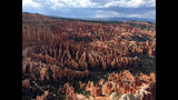 FILE - This May 25, 2017 file photo shows a view of the world-famous hoodoos, also called tent rocks, fairy chimneys and earth pyramids, at Inspiration Point in Bryce Canyon National Park in Utah. Officials say a tour bus has crashed near a national park in southern Utah, killing at least four people. Utah Highway Patrol troopers said Friday, Sept. 20, 2019 that the crash on a highway near Bryce Canyon National Park also left a number of people seriously injured. (AP Photo/Eva Parziale, Fila)