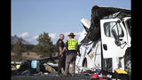Two Utah Highway patrolmen continue to work the scene where at least four people were killed in a tour bus crash near Bryce Canyon National Park, Friday, Sept. 20, 2019, in Utah. (Spenser Heaps/The Deseret News via AP)