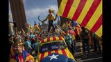 Protesters hold esteladas or Catalan independence flags as they take part in a demonstration during the Catalan National Day in Barcelona, Spain, Wednesday, Sept. 11, 2019. The Sept. 11 holiday memorializes the fall of Barcelona in the Spanish War of Succession in 1714. Since 2012, it has become the date of massive rallies for the region's secessionist movement. (AP Photo/Bernat Armangue)