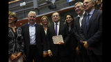 European Central Bank President Mario Draghi, center, poses with a group photo along with European Parliament members before addressing them at the European Parliament in Brussels, Monday, Sept. 23, 2019. (AP Photo/Francisco Seco)