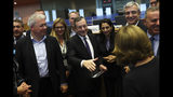 European Central Bank President Mario Draghi, center, is greeted by European Parliament members before addressing them at the European Parliament in Brussels, Monday, Sept. 23, 2019. (AP Photo/Francisco Seco)