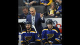 St. Louis Blues' coach Craig Berube directs play from behind Robby Fabbri (15) and Kim Kostin (37), of Russia, during the second period of an NHL preseason hockey game against the Columbus Blue Jackets, Sunday, Sept. 22, 2019, in St. Louis. (AP Photo/Bill Boyce)