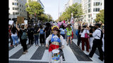 Protesters block the intersection of K and 16th Street NW, near the White House in Washington, Monday, Sept. 23, 2019. A broad coalition of climate and social justice organizations are disrupting the morning rush hour commute. (AP Photo/Pablo Martinez Monsivais)