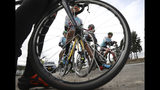 Members of the Esteban Chaves Foundation cycling team wait for time trial training in Puente Piedra near in Bogota, Colombia, Friday, Sept. 13, 2019. Although the team members must comply with mandatory doping tests, most Colombian cyclists can dope without breaking the law. The sale and traffic of performance enhancing drugs is legal in Colombia, meaning substances such as EPO can be bought over the counter. (AP Photo/Fernando Vergara)