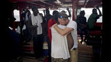 Basile Fischer, SOS Mediterranee's deputy search and rescue coordinator, right, hugs one of the rescued men aboard the Ocean Viking in the Mediterranean Sea, Monday, Sept. 23, 2019. Italy has granted the ship permission to sail to the port of Messina in Italy to disembark 182 migrants rescued north of Libya. (AP Photo/Renata Brito)