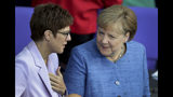German Defence Minister Annegret Kramp-Karrenbauer, left, and German Chancellor Angela Merkel, right, talk prior to a meeting of the German federal parliament, Bundestag, at the Reichstag building in Berlin, Germany, Wednesday, Sept. 11, 2019. (AP Photo/Michael Sohn)