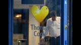 A security person stands next to the entrance of the German headquarters of travel company Thomas Cook in Oberursel near Frankfurt, Germany, Monday, Sept. 23, 2019. Thomas Cook declared bankruptcy. (AP Photo/Michael Probst)