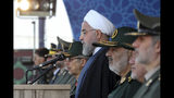 In this photo released by the official website of the office of the Iranian Presidency, President Hassan Rouhani reviews a military parade marking 39th anniversary of outset of Iran-Iraq war, in front of the shrine of the late revolutionary founder Ayatollah Khomeini, just outside Tehran, Iran, Sunday, Sept. 22, 2019. Rouhani said Sunday his country should lead regional security in the strategic Persian Gulf and warned against the presence of foreign forces, as the country's nuclear deal with world powers collapses and the U.S. deployed more troops to boost security for its Arab allies. (Iranian Presidency Office via AP)
