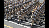 In this photo released by the official website of the office of the Iranian Presidency, Iranian army troops march at a military parade marking 39th anniversary of outset of Iran-Iraq war, in front of the shrine of the late revolutionary founder Ayatollah Khomeini, just outside Tehran, Iran, Sunday, Sept. 22, 2019. Speaking during the parade, President Rouhani said his country should lead regional security in the strategic Persian Gulf and warned against the presence of foreign forces, as the country's nuclear deal with world powers collapses and the U.S. deployed more troops to boost security for its Arab allies. (Iranian Presidency Office via AP)