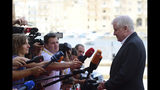 Germany's Interior Minister Horst Seehofer talks with reporters as arrives for an informal meeting of EU interior ministers in Valetta, Malta, Monday, Sept. 23, 2019. The interior ministers from Italy, Malta, France and Germany were meeting in Malta on Monday to develop some automatic mechanism to assure that those rescued at sea will be distributed among other countries and not be the responsibility of the nations where they land. (AP Photo/Jonathan Borg)