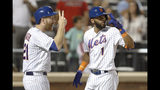 New York Mets' Todd Frazier, left celebrates with Amed Rosario (1) after scoring on Rosario's sixth-inning grand slam in a baseball game against the Miami Marlins, Monday, Sept. 23, 2019, in New York. (AP Photo/Kathy Willens)