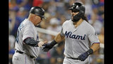 Miami Marlins third base coach Fredi Gonzalez greets Jorge Alfaro (38) as Alfaro rounds the bases after hitting a solo home run during the second inning of a baseball game against the New York Mets, Monday, Sept. 23, 2019, in New York. (AP Photo/Kathy Willens)