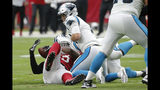 Arizona Cardinals linebacker Chandler Jones strips the ball from Carolina Panthers quarterback Kyle Allen, right, for the turnover during the first half of an NFL football game, Sunday, Sept. 22, 2019, in Glendale, Ariz. (AP Photo/Rick Scuteri)