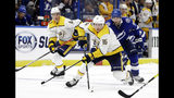 Nashville Predators center Rem Pitlick (16) carries the puck past Tampa Bay Lightning defenseman Victor Hedman (77) during the third period of an NHL preseason hockey game Friday, Sept. 20, 2019, in Tampa, Fla. (AP Photo/Chris O'Meara)