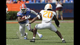 Florida running back Dameon Pierce (27) looks for room to get around Tennessee defensive back Bryce Thompson (20) during the second half of an NCAA college football game, Saturday, Sept. 21, 2019, in Gainesville, Fla. (AP Photo/John Raoux)
