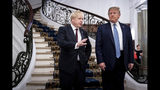 FILE - In this Aug. 25, 2019, file photo, President Donald Trump and Britain's Prime Minister Boris Johnson, left, speak to the media before a working breakfast meeting at the Hotel du Palais on the sidelines of the G-7 summit in Biarritz, France. Johnson says he'll tell President Donald Trump that the U.K.'s state-funded health service will be off the table in any future trade negotiations, and that the U.S. will have to open its markets to British goods if it wants to make a deal. (Erin Schaff/The New York Times, Pool, File)