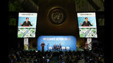 France's President Emmanuel Macron addresses the Climate Action Summit in the United Nations General Assembly, at U.N. headquarters, Monday, Sept. 23, 2019. (AP Photo/Jason DeCrow)