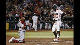 Arizona Diamondbacks' Christian Walker (53) touches home plate after hitting a home run as St. Louis Cardinals catcher Yadier Molina, left, pauses behind home plate during the fourth inning of a baseball game Monday, Sept. 23, 2019, in Phoenix. (AP Photo/Ross D. Franklin)