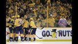 FILE - In this April 29, 2018, file photo, Nashville Predators fans celebrate along with players after the Predators scored a goal against the Winnipeg Jets during Game 2 of an NHL hockey second-round playoff series in Nashville, Tenn. The Detroit Red Wings are desperately trying to keep fans filing into Little Caesars Arena while the allure of the relatively new facility wears off while the team goes through a painful rebuild. Every other team in the NHL _ and other leagues _ is also trying to give spectators good reason to come to the arena instead of enjoying games on TV from home or the local watering hole. (AP Photo/Mark Humphrey, File)