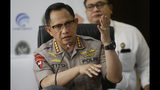 National Police Chief Gen. Tito Karnavian, gestures as he speaks during a press conference in Jakarta, Indonesia, Tuesday, Sept. 24, 2019. The death toll from violent protests in Indonesia's restive Papua province has risen to 26 after several bodies were found under burned buildings, officials said Tuesday. (AP Photo/Achmad Ibrahim)