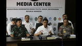 Indonesian Coordinating Minister for Security and Political Affairs Wiranto, center, speaks to the media as National Police Chief Gen. Tito Karnavian, right, and Armed Forces Chief Air Marshall Hadi Tjahjanto, left, listen, during a press conference in Jakarta, Indonesia, Tuesday, Sept. 24, 2019. The death toll from violent protests in Indonesia's restive Papua province has risen to 26 after several bodies were found under burned buildings, officials said Tuesday. (AP Photo/Achmad Ibrahim)