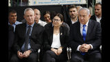 FILE - In this Thursday, Sept. 19, 2019 file photo, Blue and White party leader Benny Gantz, left, Esther Hayut, the Chief Justice of the Supreme Court of Israel, and Prime Minister Benjamin Netanyahu attend a memorial service for former President Shimon Peres in Jerusalem. Israel's two largest political parties are meeting to discuss the possibility of forming a unity government between them, after last week's deadlocked national elections. The Sept. 23 meeting comes a day after Blue and White leader Benny Gantz and Prime Minister Benjamin Netanyahu of the rival Likud party held their first meeting since the polling.(AP Photo/Ariel Schalit, File)