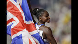 Dina Asher-Smith of Great Britain celebrates winning the gold medal in the women's 200 meters final at the World Athletics Championships in Doha, Qatar, Wednesday, Oct. 2, 2019. (AP Photo/Petr David Josek)