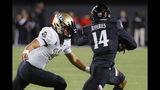 Cincinnati cornerback Cam Jefferies (14) stiff-arms UCF quarterback Dillon Gabriel (11) after intercepting a pass during the first half of an NCAA college football game Friday, Oct. 4, 2019, in Cincinnati. (AP Photo/John Minchillo)