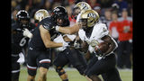 UCF running back Greg McCrae (30) carries during the first half of the team's NCAA college football game against Cincinnati, Friday, Oct. 4, 2019, in Cincinnati. (AP Photo/John Minchillo)