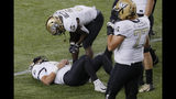 UCF quarterback Dillon Gabriel (11) lies on the field with an apparent injury during the first half of the team's NCAA college football game against Cincinnati, Friday, Oct. 4, 2019, in Cincinnati. (AP Photo/John Minchillo)
