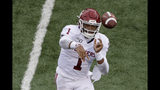 Oklahoma quarterback Jalen Hurts (1) throws a pass during the first half of an NCAA college football game against Kansas, Saturday, Oct. 5, 2019, in Lawrence, Kan. (AP Photo/Charlie Riedel)