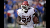 Oklahoma running back Rhamondre Stevenson runs for a touchdown during the second half of an NCAA college football game against Kansas, Saturday, Oct. 5, 2019, in Lawrence, Kan. (AP Photo/Charlie Riedel)