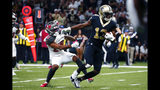 New Orleans Saints wide receiver Michael Thomas (13) breaks away from Tampa Bay Buccaneers defensive back Sean Murphy-Bunting on a touchdown reception in the second half of an NFL football game in New Orleans, Sunday, Oct. 6, 2019. (AP Photo/Butch Dill)