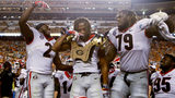 Georgia defensive back Richard LeCounte III (2) and offensive lineman Isaiah Wilson (79) celebrate with defensive back Eric Stokes after Stokes' sack of Tennessee quarterback Brian Maurer led to a fumble and a Georgia touchdown during an NCAA college football game Saturday, Oct. 5, 2019, in Knoxville, Tenn. (C.B. Schmelter/Chattanooga Times Free Press via AP)