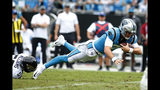 Carolina Panthers quarterback Kyle Allen (7) dives while Jacksonville Jaguars linebacker Quincy Williams (56) tackles during the second half of an NFL football game in Charlotte, N.C., Sunday, Oct. 6, 2019. (AP Photo/Brian Blanco)