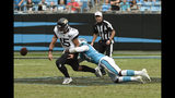 Carolina Panthers linebacker Brian Burns (53) tackles Jacksonville Jaguars quarterback Gardner Minshew (15) forcing a fumble during the second half of an NFL football game in Charlotte, N.C., Sunday, Oct. 6, 2019. (AP Photo/Mike McCarn)