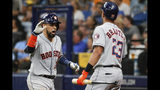 Houston Astros' Robinson Chirinos, left, celebrates his home run against the Tampa Bay Rays with Michael Brantley (23) during the eighth inning of Game 4 of a baseball American League Division Series, Tuesday, Oct. 8, 2019, in St. Petersburg, Fla. (AP Photo/Scott Audette)