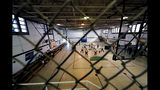 Detainees play volleyball in a gymnasium inside the Winn Correctional Center in Winnfield, La., Thursday, Sept. 26, 2019. (AP Photo/Gerald Herbert)