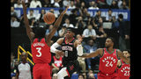 Houston Rockets' Russell Westbrook, center, passes the ball under pressure by Toronto Raptors' OG Anunoby, left, and Norman Powell during the first half of an NBA preseason basketball game Tuesday, Oct. 8, 2019, in Saitama, near Tokyo. (AP Photo/Jae C. Hong)