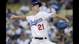 Los Angeles Dodgers starting pitcher Walker Buehler throws to a Washington Nationals batter during the first inning of Game 1 of a baseball National League Divisional Series on Thursday, Oct. 3, 2019, in Los Angeles. (AP Photo/Marcio Jose Sanchez)