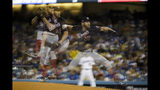 In this multiple-exposure photo, Washington Nationals starting pitcher Stephen Strasburg throws to a Los Angeles Dodgers batter during the third inning in Game 2 of a baseball National League Division Series on Friday, Oct. 4, 2019, in Los Angeles. (AP Photo/Marcio Jose Sanchez)