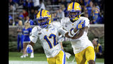 Pittsburgh's Paris Ford (12) celebrates with Damar Hamlin after Ford scored a touchdown after an interception during the first half of an NCAA college football game against Duke in Durham, N.C., Saturday, Oct 5, 2019. (AP Photo/Ben McKeown)