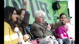 Stanley Johnson, second right, father of the British Prime Minister Boris Johnson, speaks at an Extinction Rebellion panel on climate change in Trafalgar Square, on the third day of ongoing demonstrations in London, Wednesday, Oct. 9, 2019. Police are reporting they have arrested more than 500 people since the start of two weeks of protests as the Extinction Rebellion group attempts to draw attention to global warming .(AP Photo/Alastair Grant)