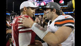 San Francisco 49ers quarterback Jimmy Garoppolo, left, greets Cleveland Browns quarterback Baker Mayfield after an NFL football game in Santa Clara, Calif., Monday, Oct. 7, 2019. (AP Photo/Tony Avelar)