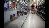 The lantern section is nearly empty at an ACE Hardware store as shoppers prepare for possible power shutoffs in Los Gatos, Calif., Tuesday, Oct. 8, 2019. Millions of people were poised to lose electricity throughout northern and central California after Pacific Gas & Electric Co. announced Tuesday it would shut off power in the largest preventive outage in state history to try to avert wildfires caused by faulty lines. (Dai Sugano/San Jose Mercury News via AP)