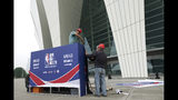 Workers dismantle signage for an NBA fan event scheduled to be held on Wednesday night at the Shanghai Oriental Sports Center in Shanghai, China, Tuesday, Oct. 8, 2019. Chinese state broadcaster CCTV announced Tuesday it will no longer air two NBA preseason games set to be played in the country. (AP Photo)