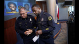 Dallas Assistant Chief of Police Avery Moore, right, walks away from the podium after addressing the media about a drug deal gone bad, resulting in the death of Joshua Brown at Dallas Police Headquarters in Dallas, Tuesday, Oct. 8, 2019. (Tom Fox/The Dallas Morning News via AP)