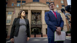 Attorney General for the Eastern District of Virginia G. Zachary Terwilliger, right, accompanied by Assistant United States Attorney Danya Atiyeh, left, takes a question from a reporter after announcing the arrest of Henry Kyle Frese, a Defense Intelligence Agency official charged with leaking classified information to two journalists, including one he was dating, during a news conference outside the federal courthouse in Alexandria, Va., Wednesday, Oct. 9, 2019. (AP Photo/Andrew Harnik)